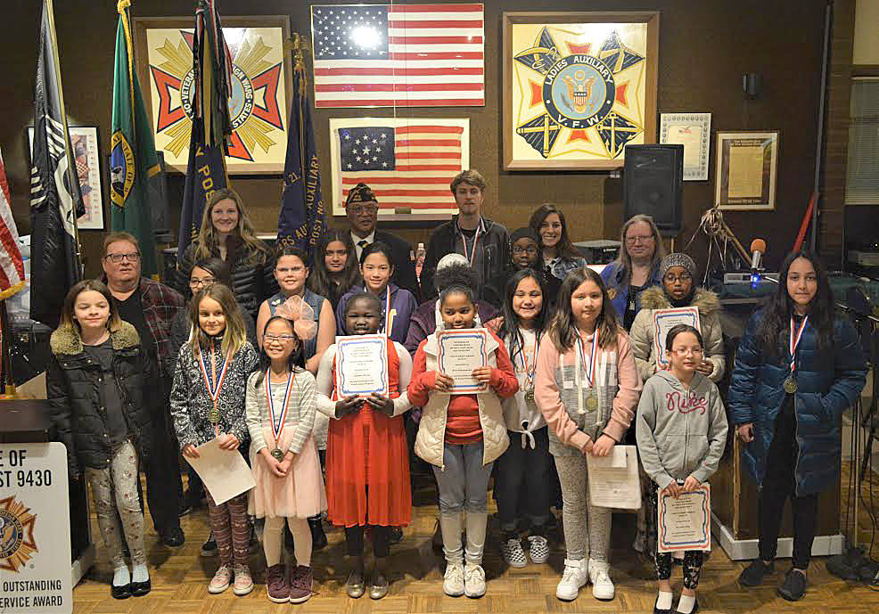 Youth essay winners and their teachers pose during the award ceremony at the Veterans of Foreign Wars Post No. 9430 in Skyway. Courtesy photo